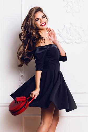 woman wearing a stylish black party dress