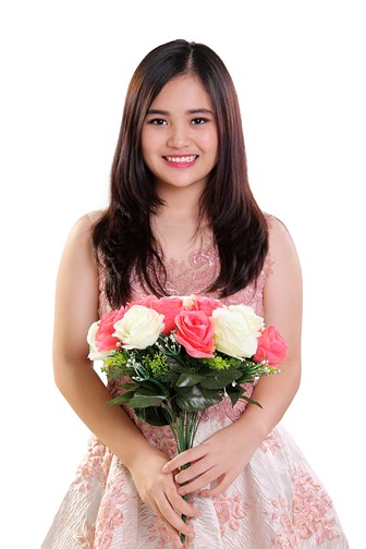 teenaged girl holding a bouquet of flowers