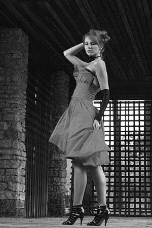 young woman wearing a stylish dress - fashion portrait