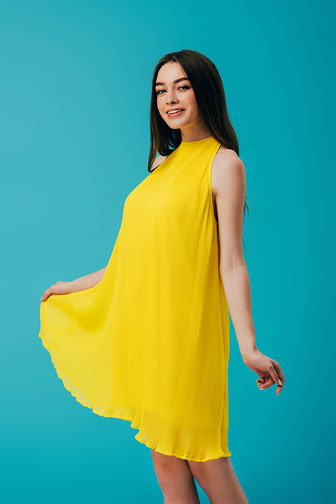 young woman wearing a yellow dress